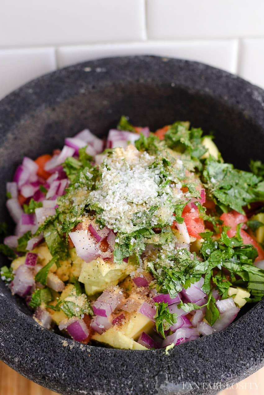 Adding spices in to guacamole recipe