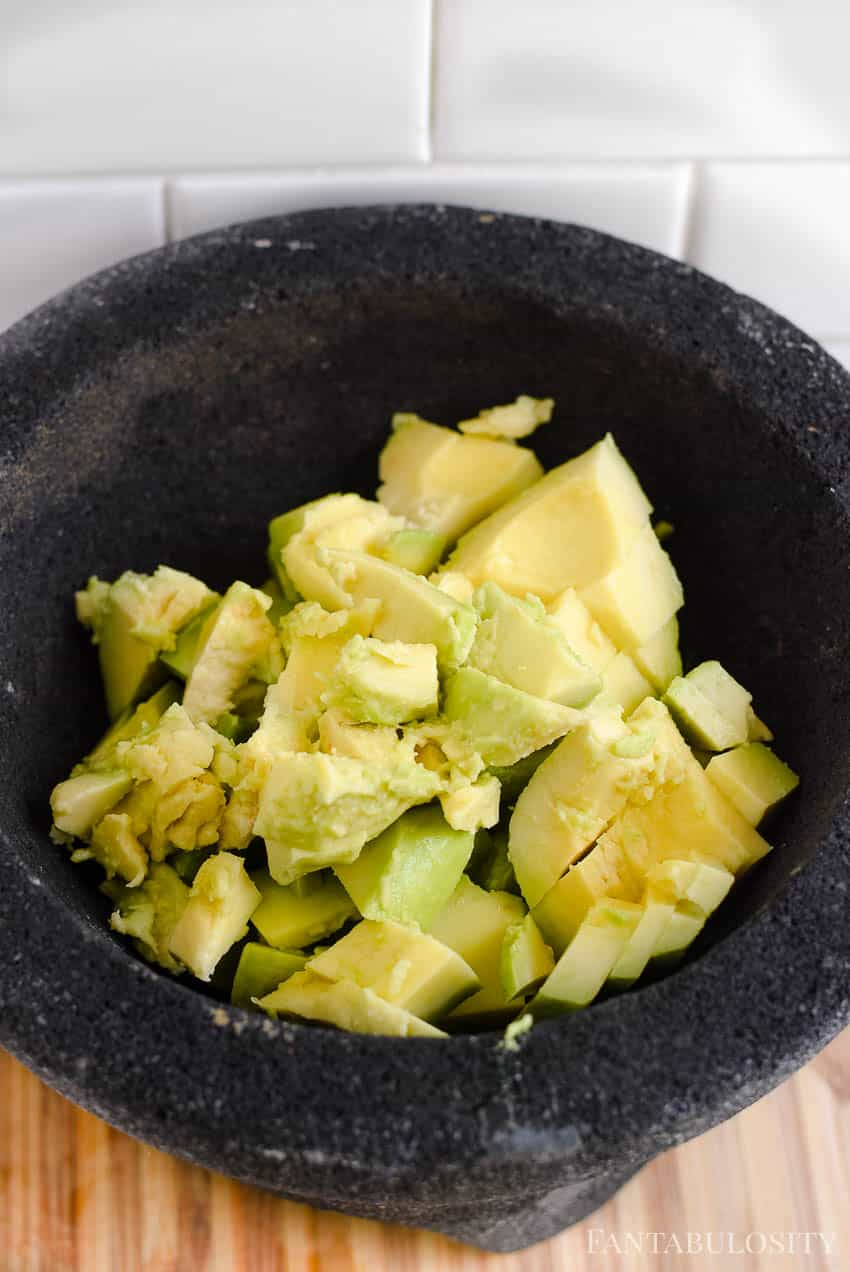 I like to cut my avocados to make mashing in a molcajete easier