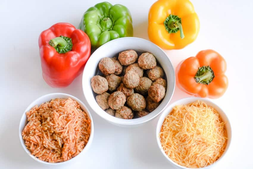 Ingredients for one of our family favorite weeknight meals. Easy Meatball Stuffed Peppers - beef meatballs, cheese, rice... it's so quick and easy!