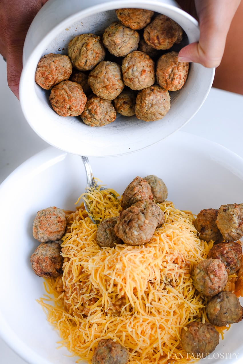 Beef meatballs mixed with rice and cheese for a stuffed bell peppers recipe