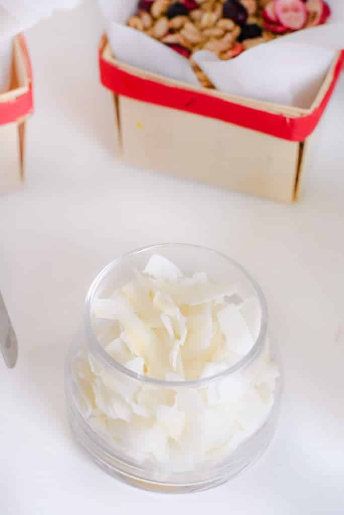 Coconut flakes for a yogurt and ice cream bar topping idea. DIY yogurt and build your own pudding bar