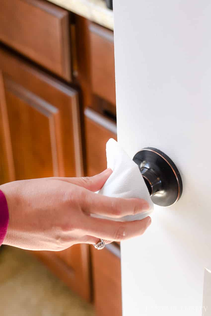 Wipe Door Handles - Lysol Laundry Sanitizer - 5 ways to keep school germs out of your home
