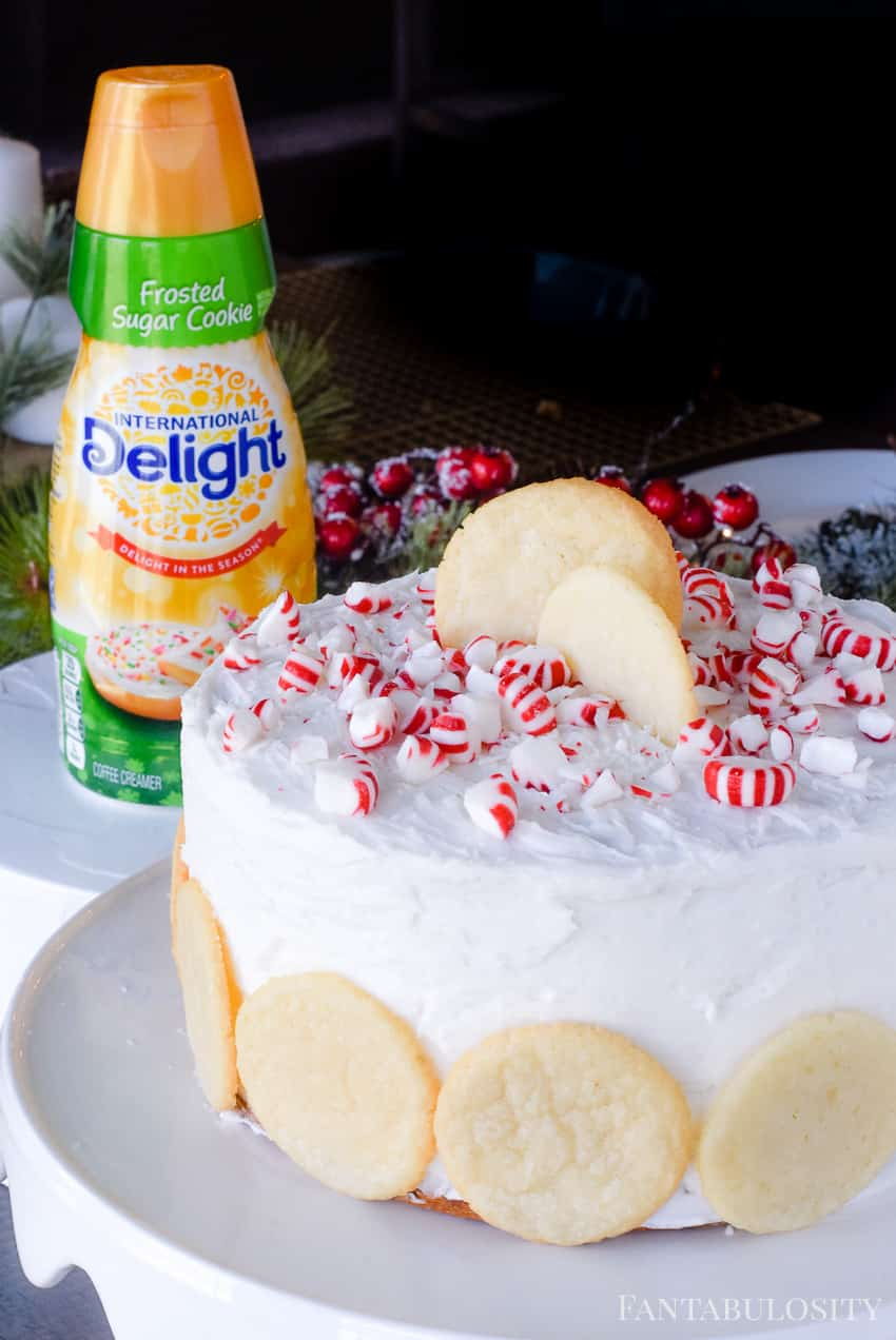 Using a flavored creamer to infuse a cake and frosting can add SO much flavor! Peppermint Sugar Cookie Cake Recipe