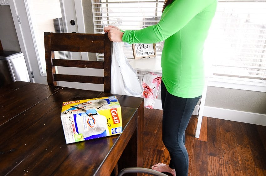 Hang trash bags in a central location