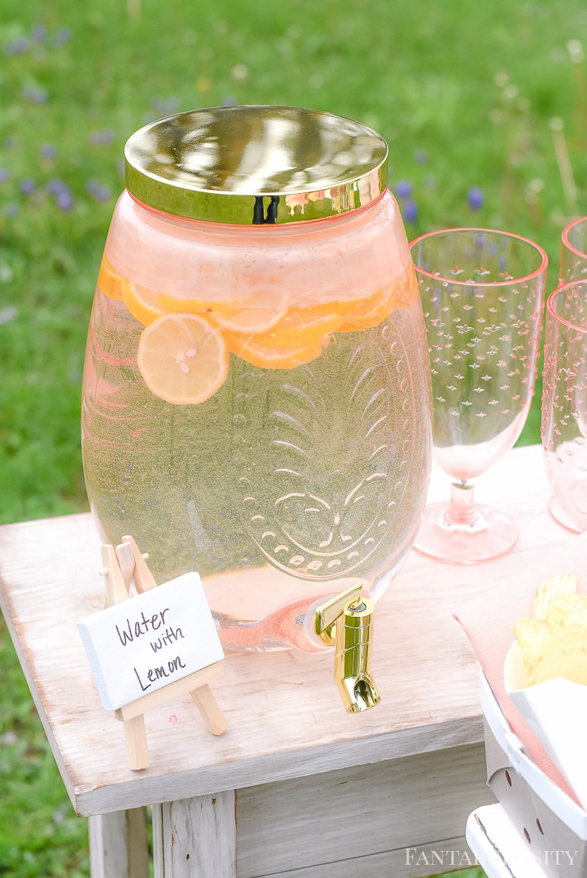Water with Lemon for outdoor party in drink dispenser