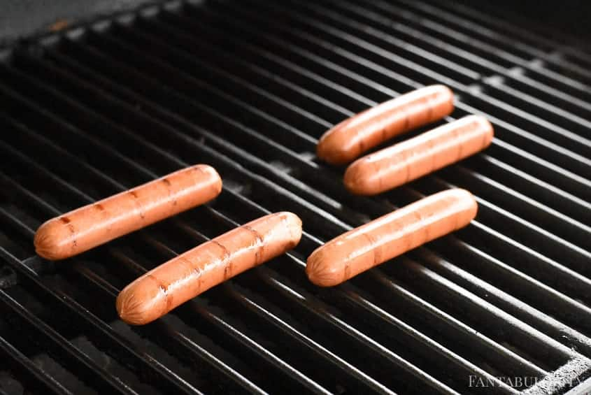 Grilling hot dogs for hot dog bar