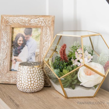 Create this easy DIY floral terrarium using only a few supplies. This tutorial will show you how to make a beautiful terrarium for your home!