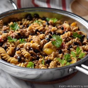 A taco pasta recipe in a skillet.