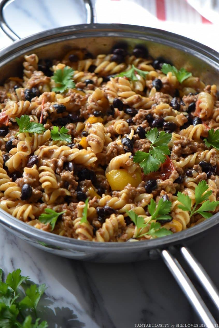 This taco pasta recipe is loaded with ground meat, juicy tomatoes and black beans.