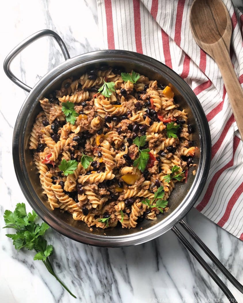 An overhead shot of the taco pasta recipe which includes some of delicious ingredients like rotini pasta, black beans and ground meat .