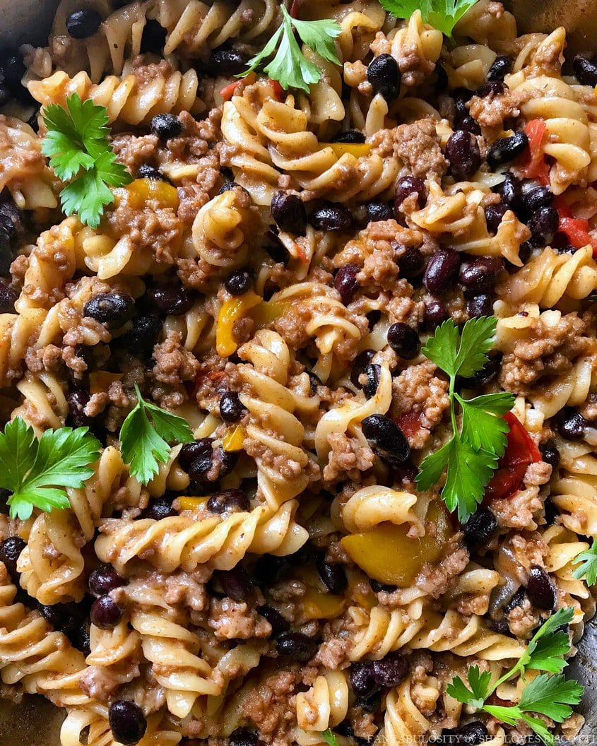 A close up of the taco pasta recipe made with rotini shaped pasta, ground meat and black beans..