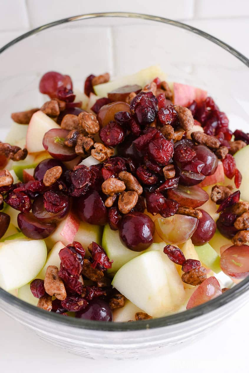 Dried cranberries and candied nuts in an apple salad