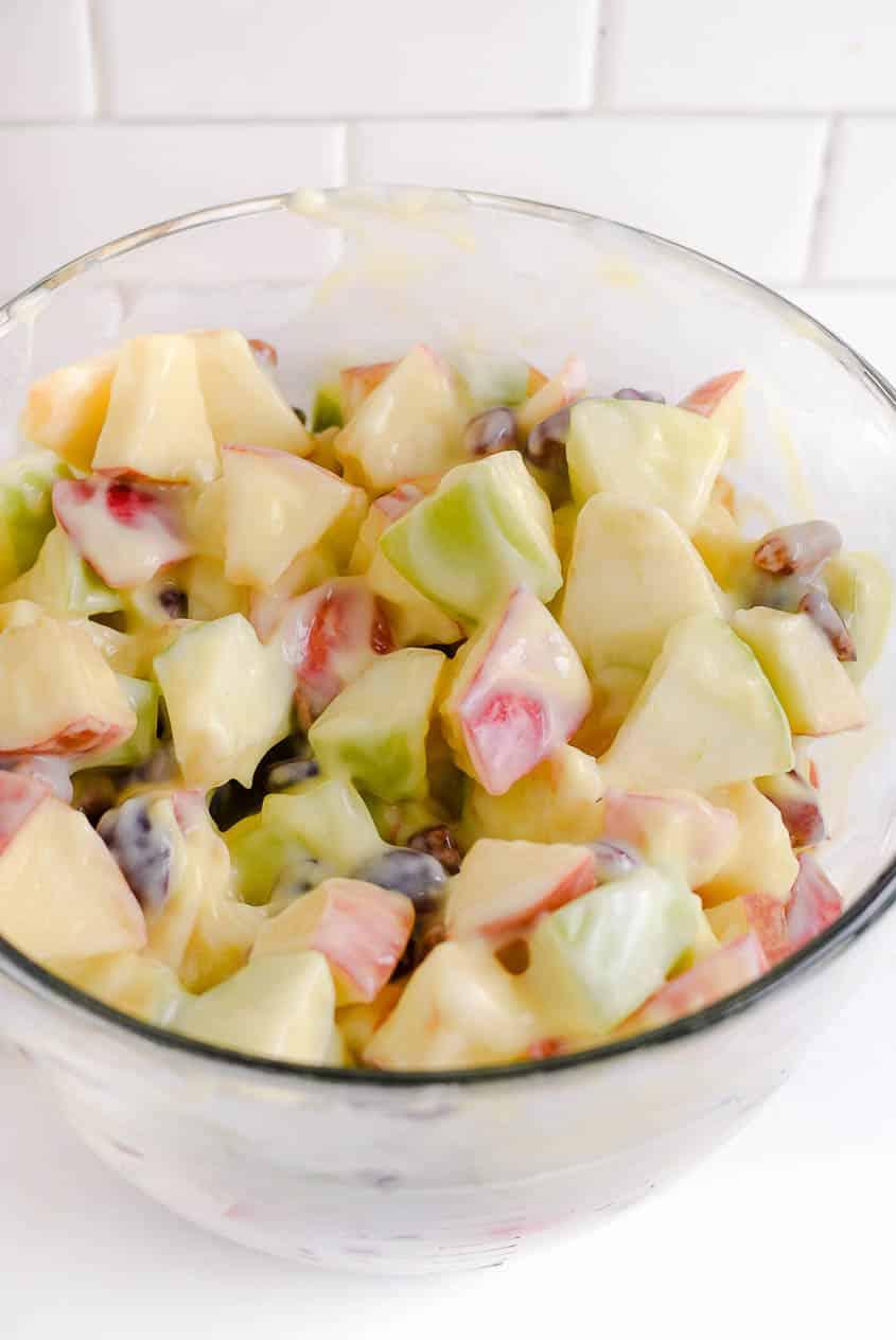 Mix together ingredients for apple salad