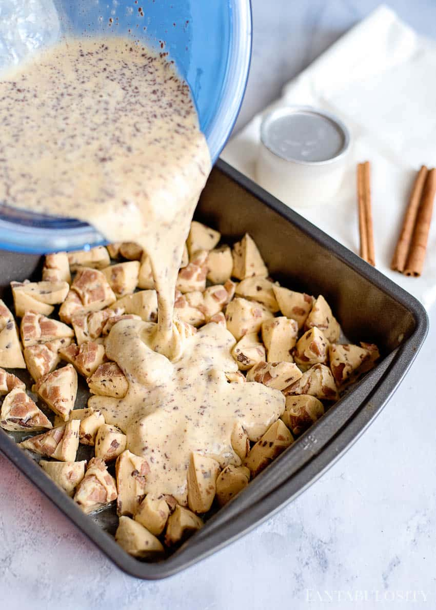 French Toast Batter over cinnamon roll casserole. Perfect for Christmas morning