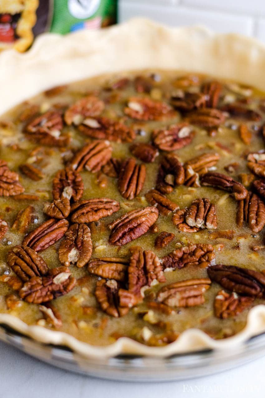 Pour batter in to pie crust and add pecans