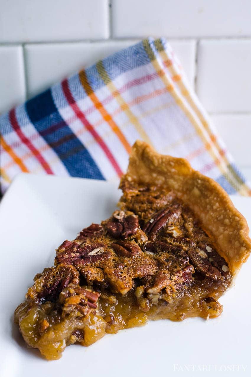 Slice pecan pie and serve