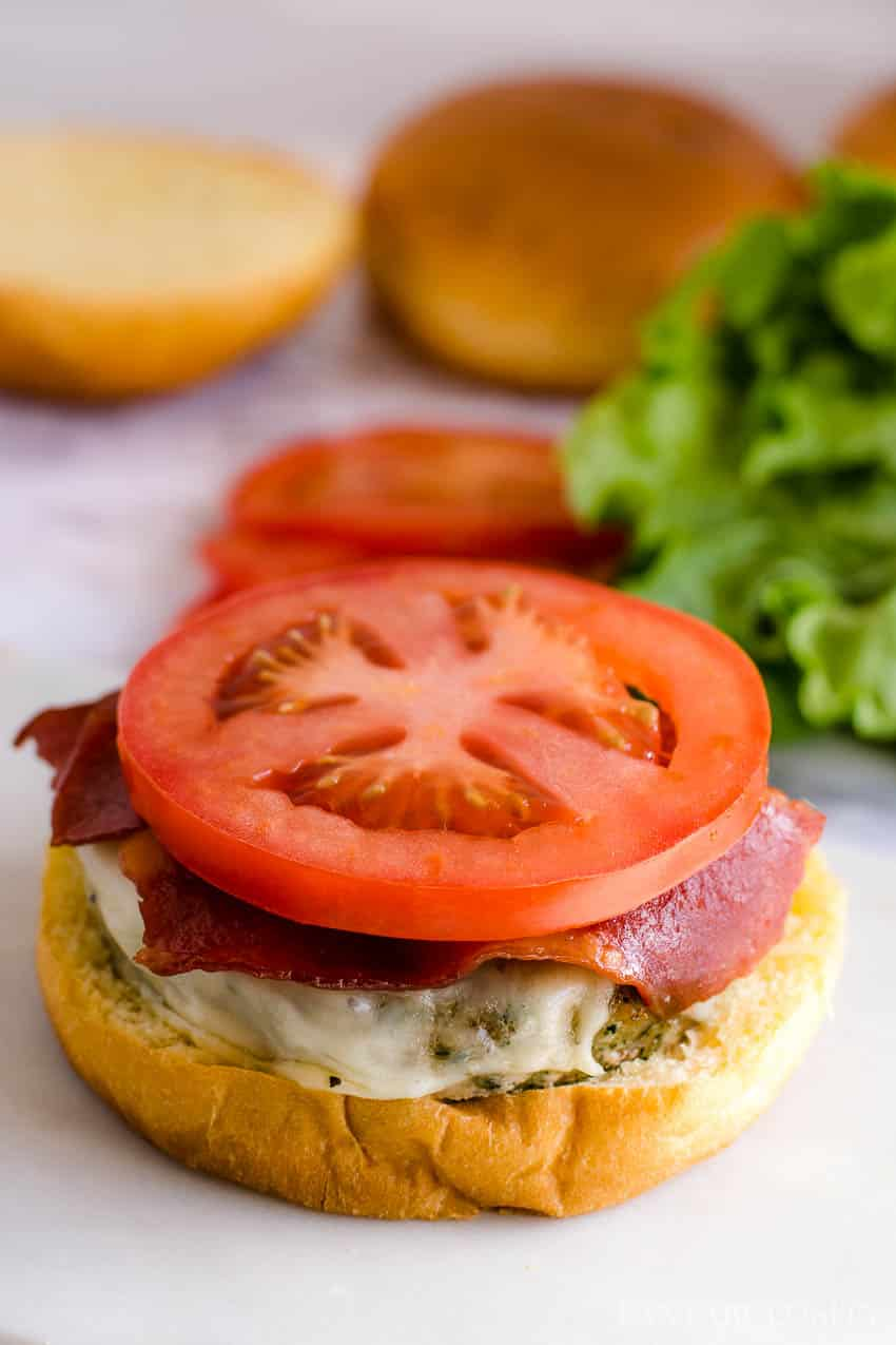 Baked turkey club burger with bacon and tomato