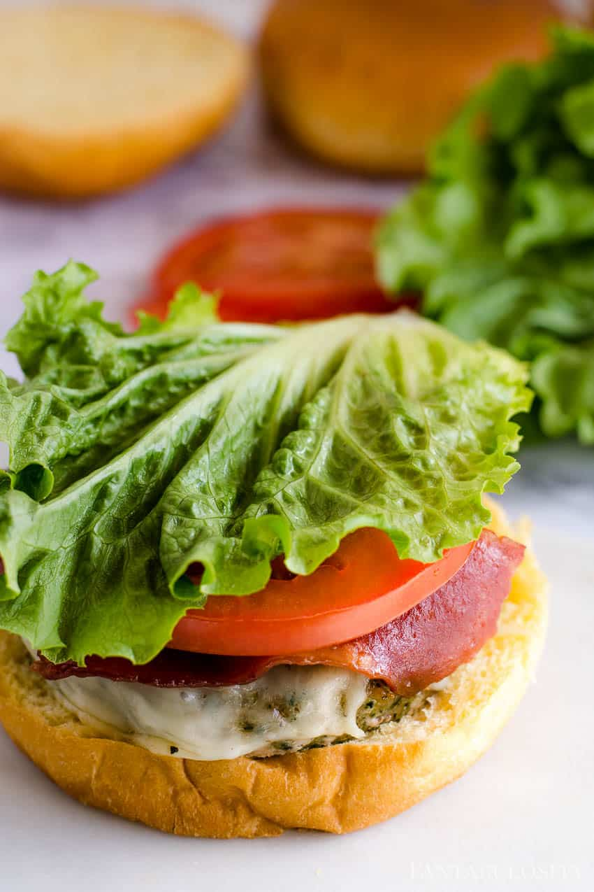 Bacon lettuce and tomato turkey club burger