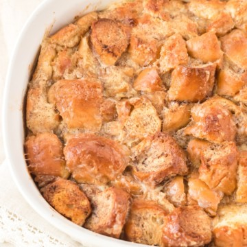 donut bread pudding in a white baking dish