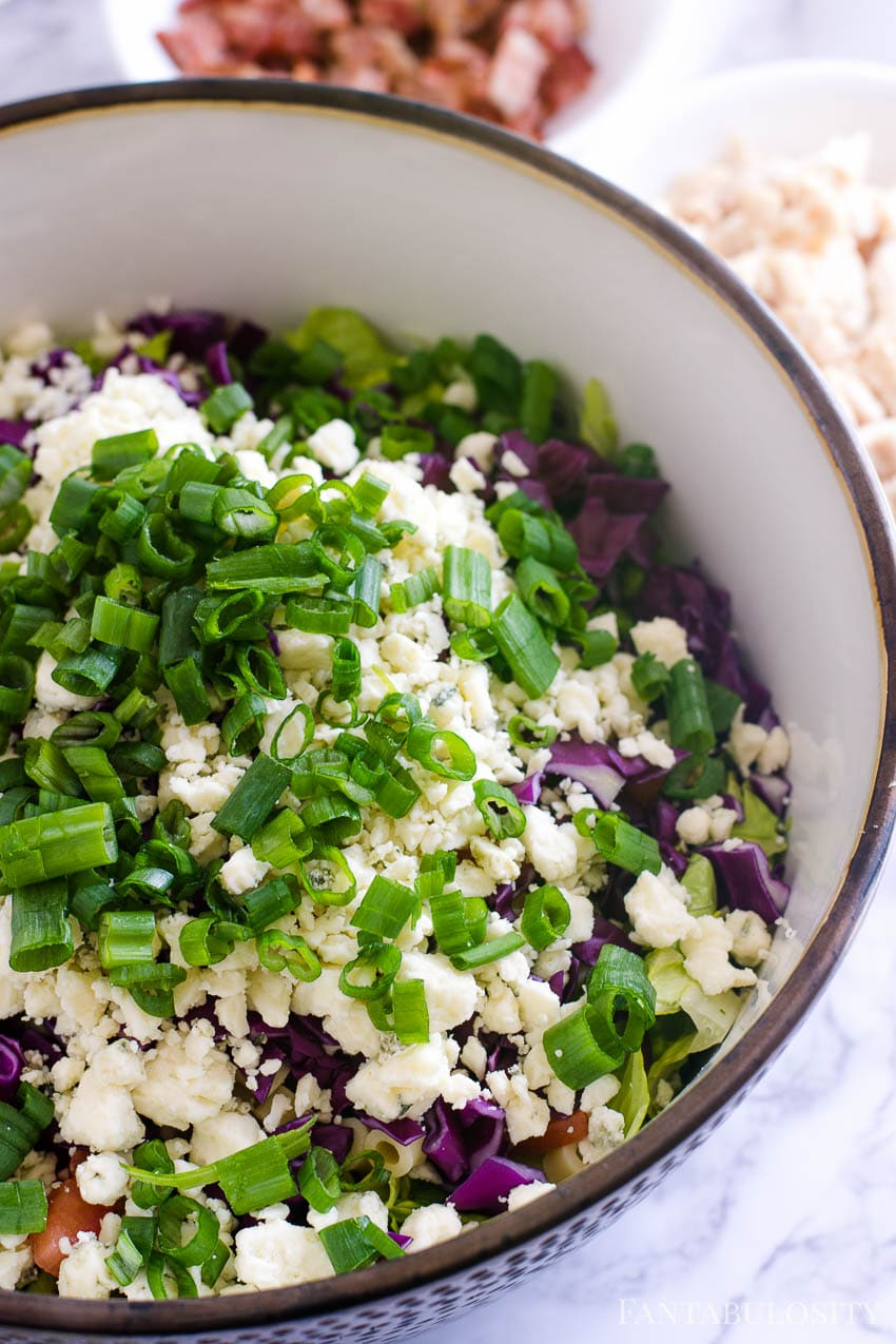 Chopped green onions on top of Italian chopped salad