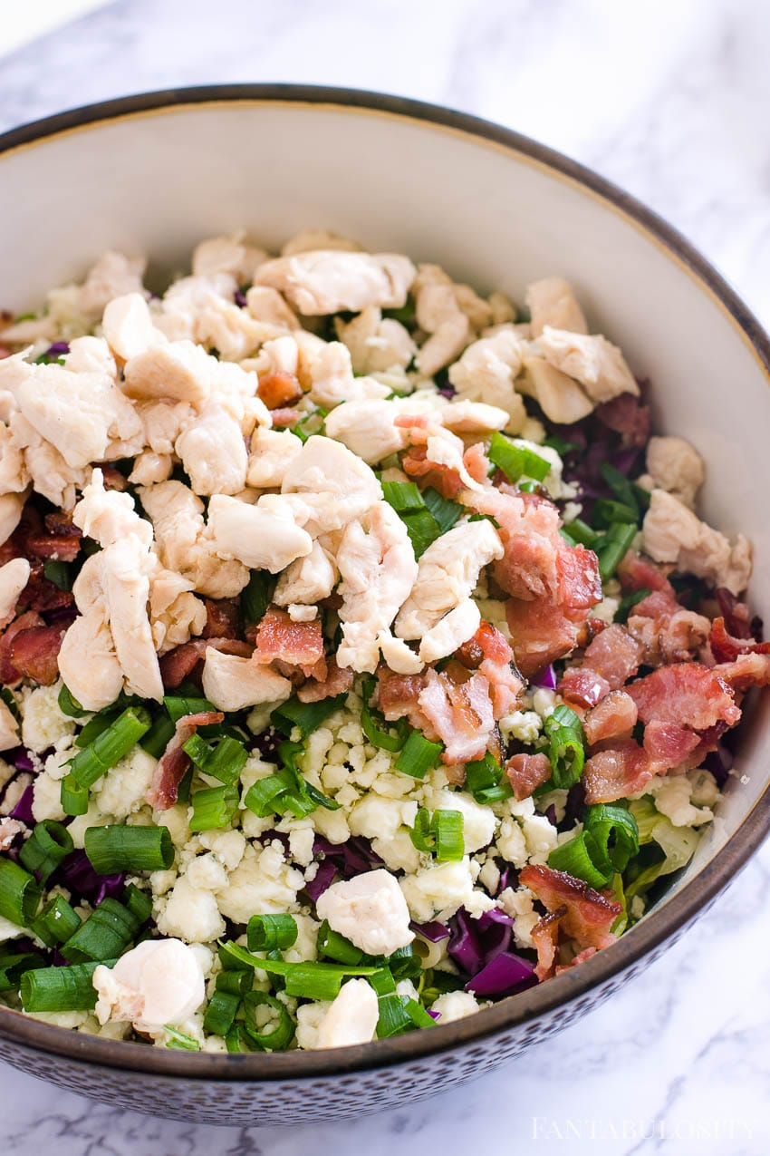 Chopped chicken on top of Italian Chopped Salad