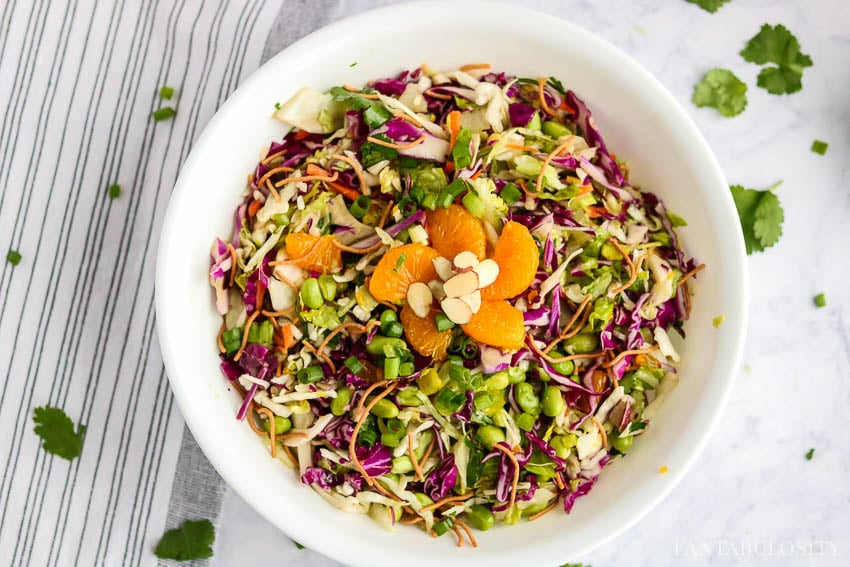 Chopped Asian Salad - in a white bowl with mandarin oranges on top
