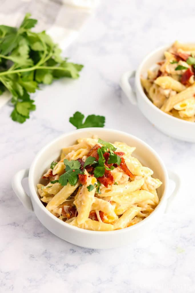 Chicken bacon ranch pasta in a white serving bowl