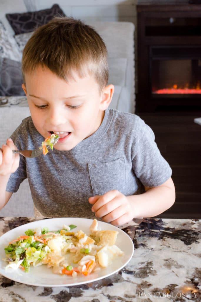 Little boy eating Schwan's