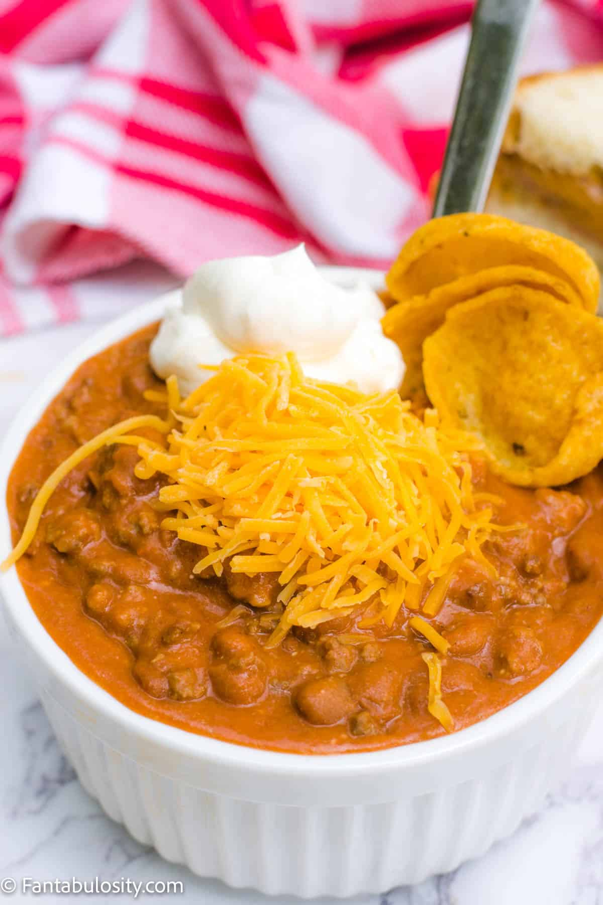Easy Chili with cheese, fritos and sour cream