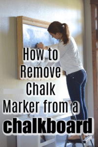 woman cleaning a chalkboard