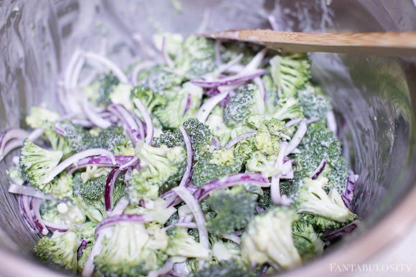 Mix together ingredients for broccoli raisin salad