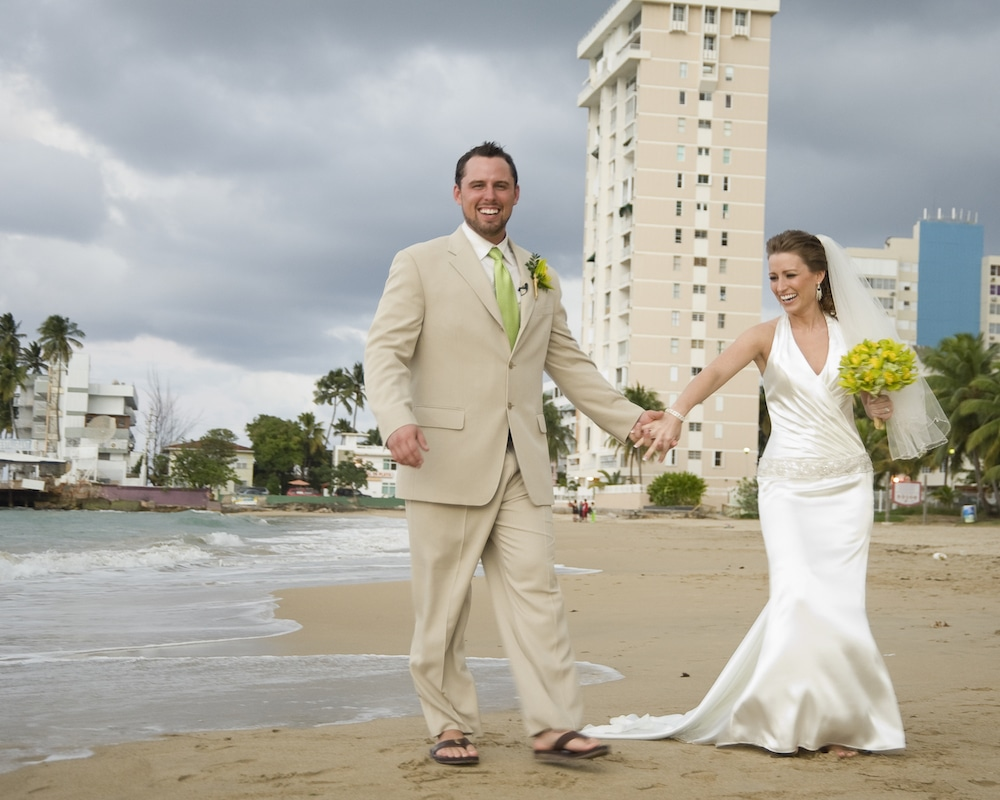 Husband and wife married on the beach