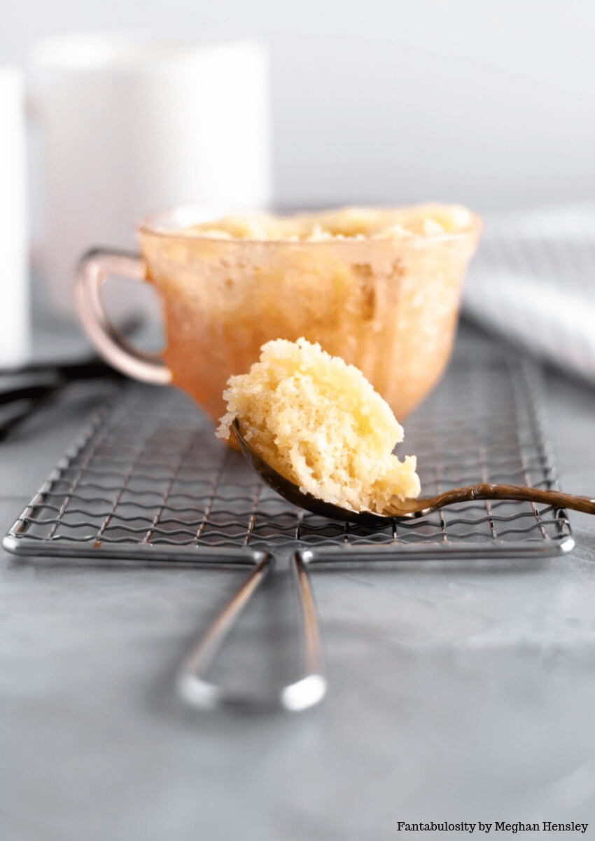 Vanilla Cake in a mug eating with a spoon