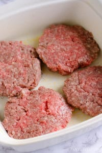 Flip the seasoned burgers over in to the baking dish and season the other side