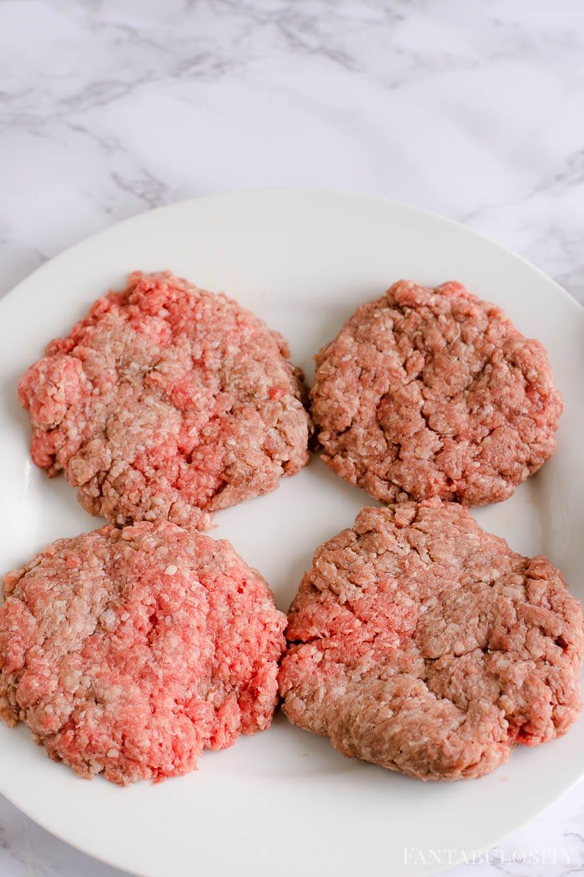 Raw hamburger patties ready to bake