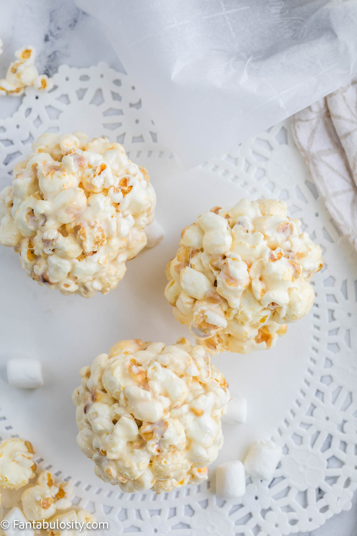 popcorn balls on white table cloth