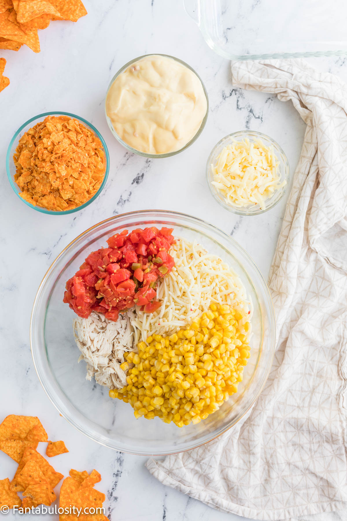 Doritos chicken casserole ingredients in a bowl
