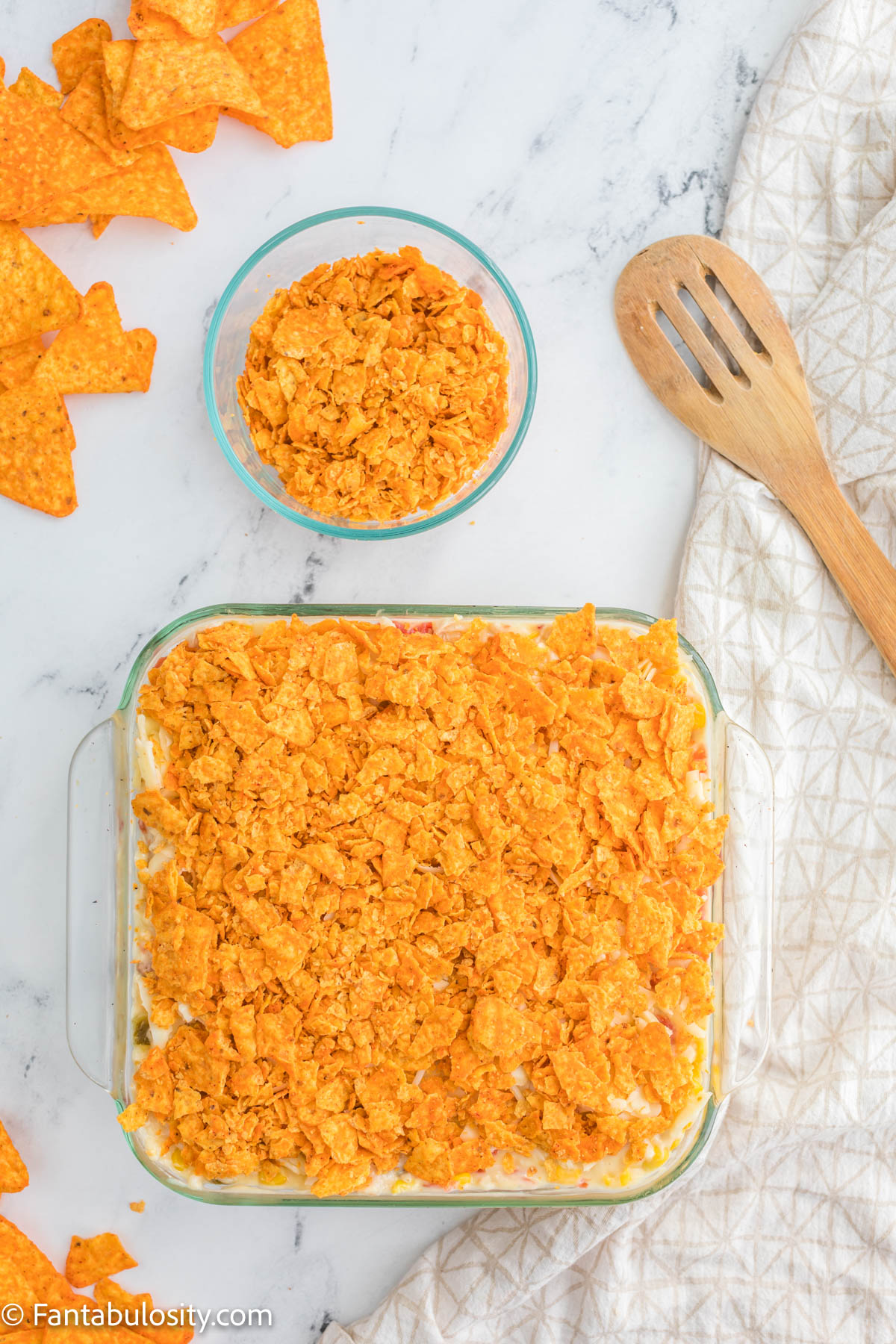 Doritos Chicken Casserole in baking dish ready for oven