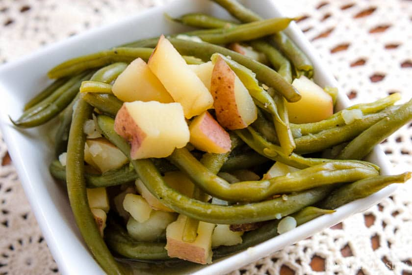 Instant Pot Green Beans and Potatoes in a white serving dish