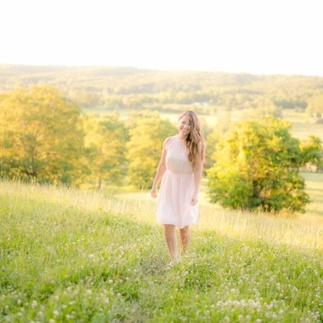 Letter to my friends: Woman wearing pink dress in the middle of a field
