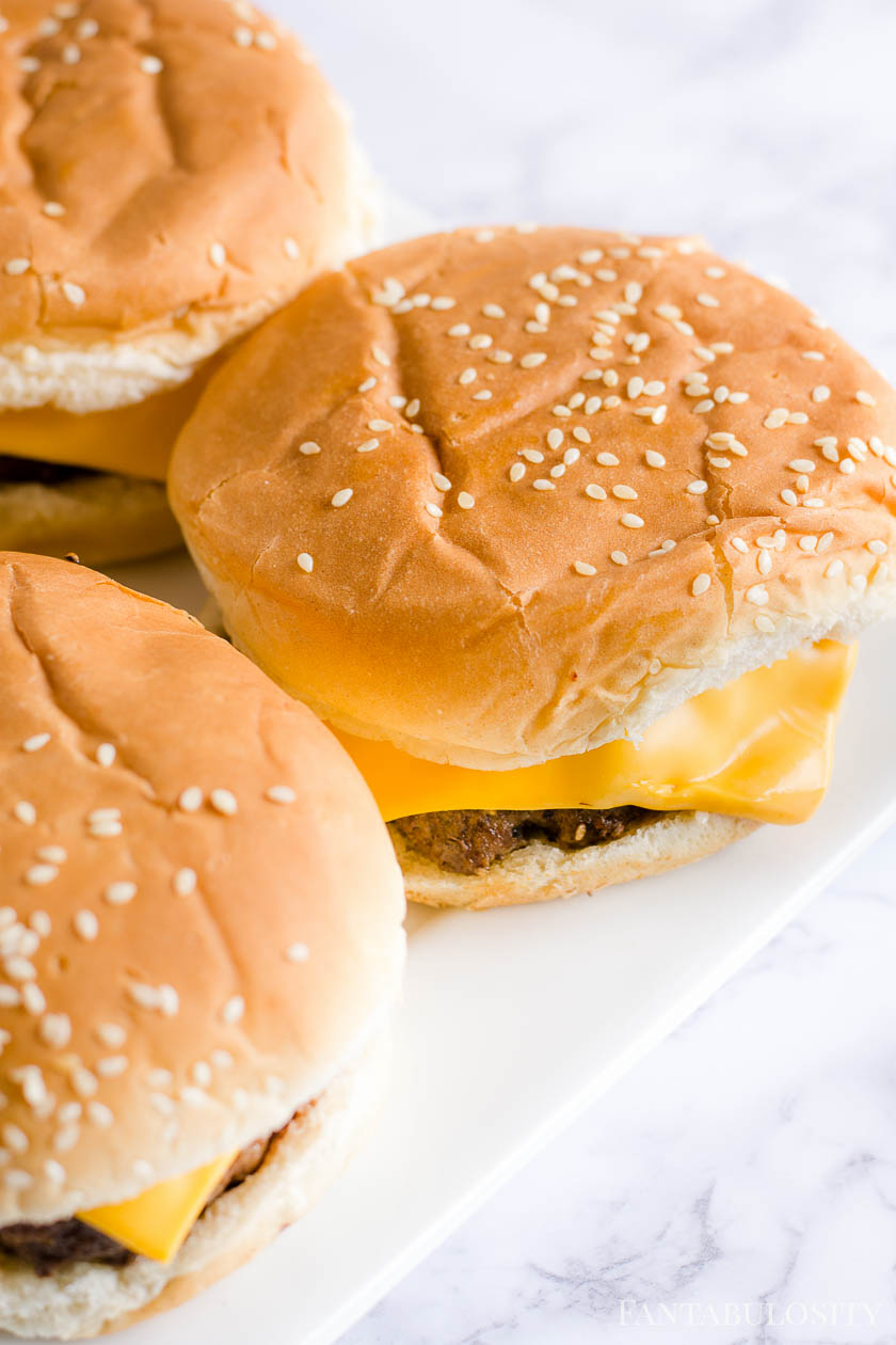 Burgers with cheese on a white plate