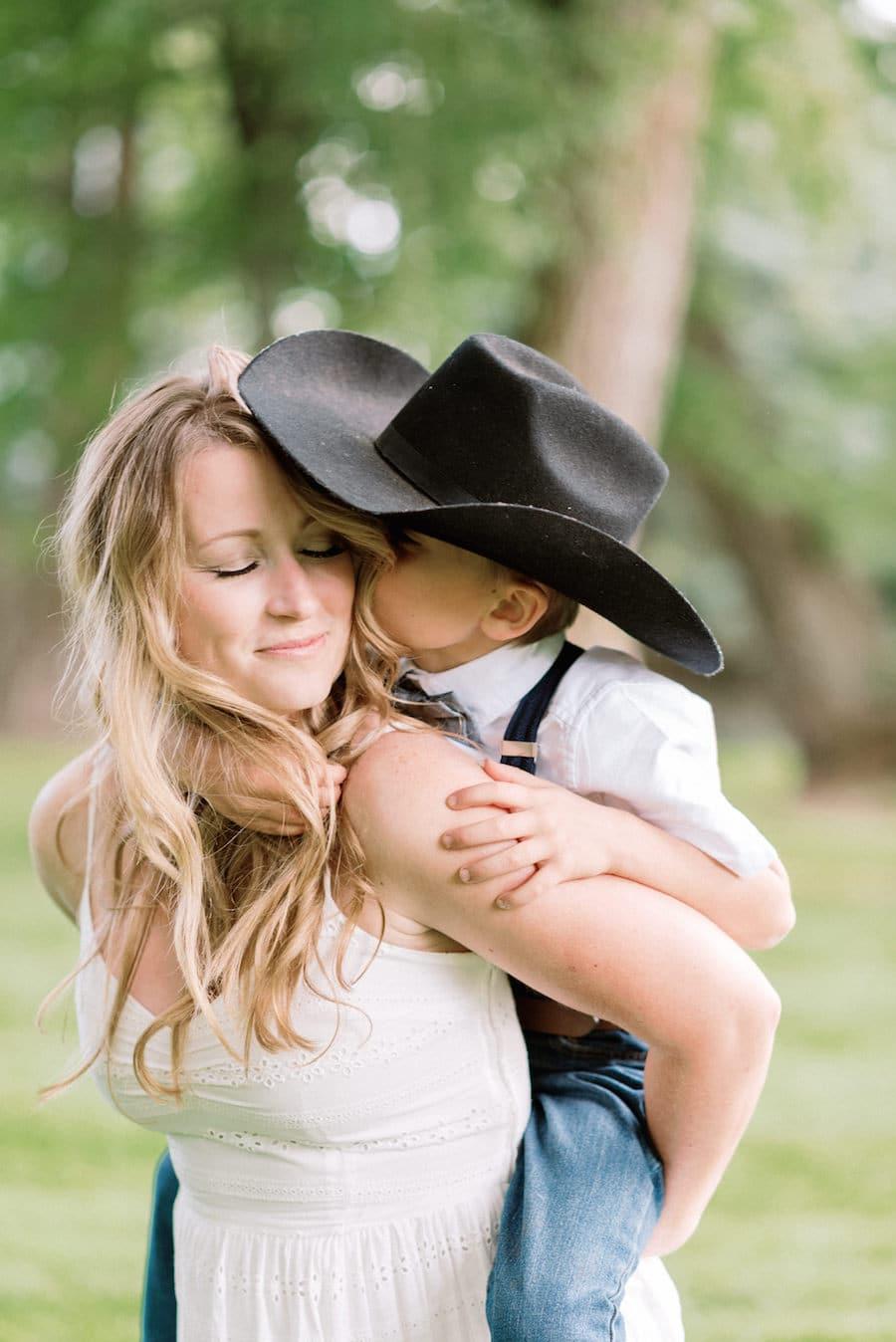Little boy kissing momma on the cheek