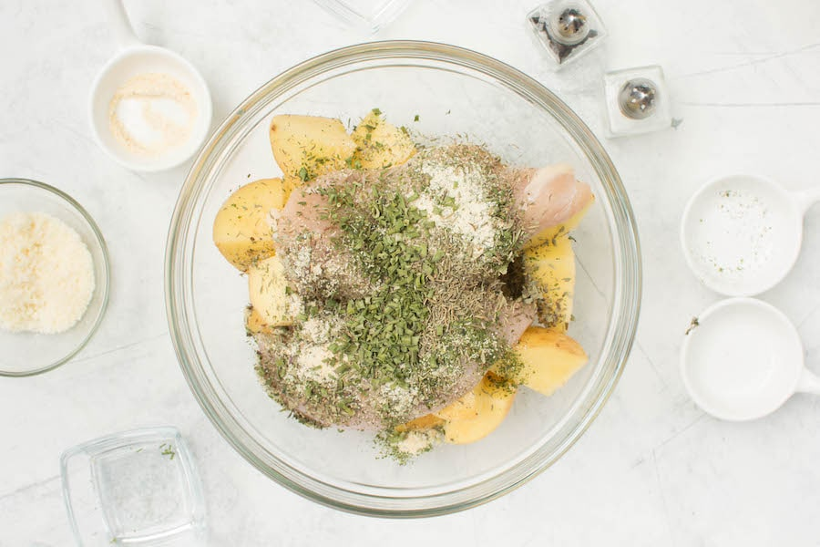 chicken potatoes and herbs in bowl