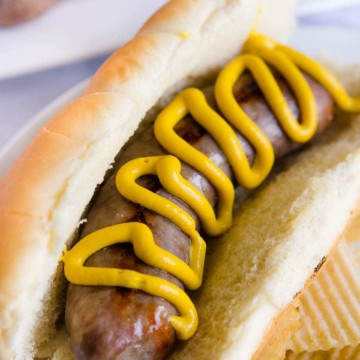 Brats cooked in the Oven and placed on a bun with mustard