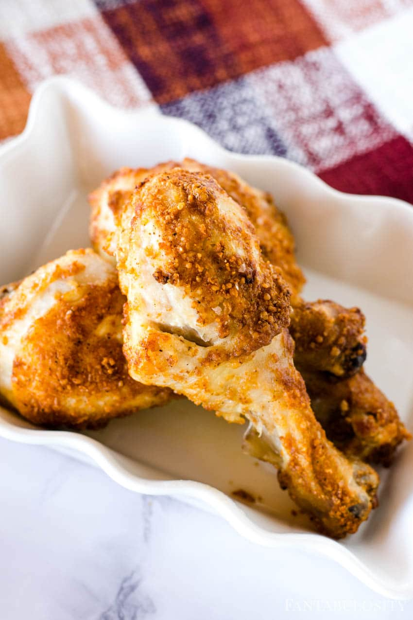 air fryer chicken legs in white dish