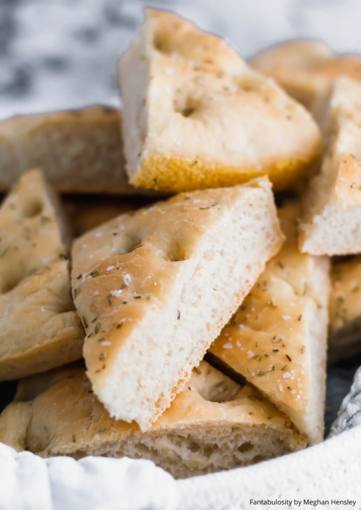 Homemade bread is easier than you think. This focaccia bread uses simple, pantry staples and transforms them into a bread with a soft, fluffy interior and perfectly chewy exterior. A definite crowd pleaser.