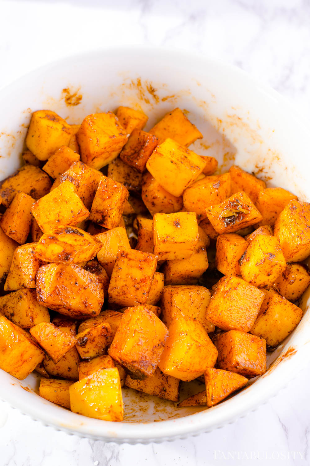 Stir butternut squash is evenly covered with spices