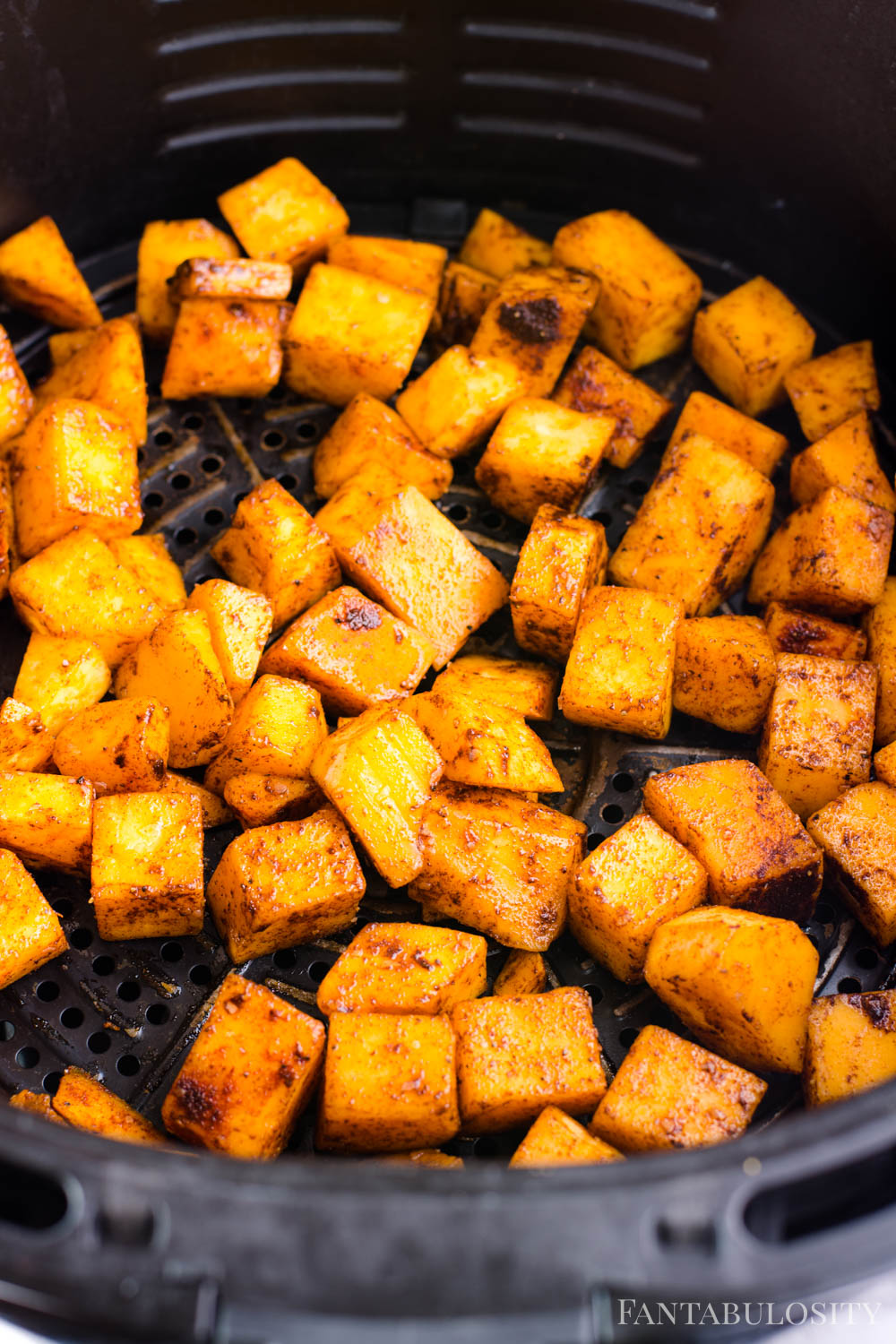 Cook butternut squash cubes in air fryer
