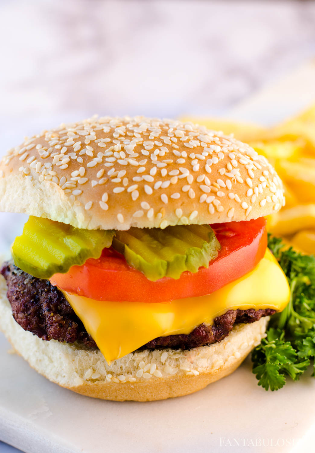 Add burger toppings like tomato, pickles, onion, mustard, lettuce