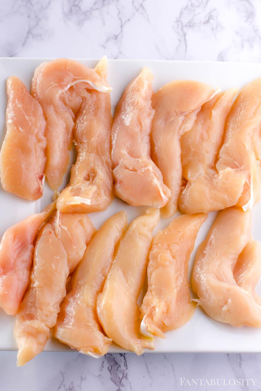 uncooked, raw chicken tenders
